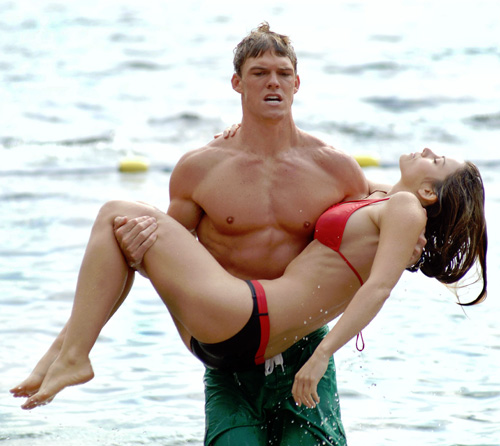 Alan Ritchson as Aquaman with Erica Durance as Lois Lane from Smallville